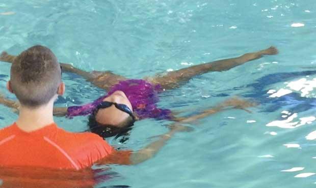 girl-swimming-on-her-back