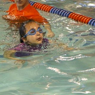 Girl swims at Goldfish Swim school