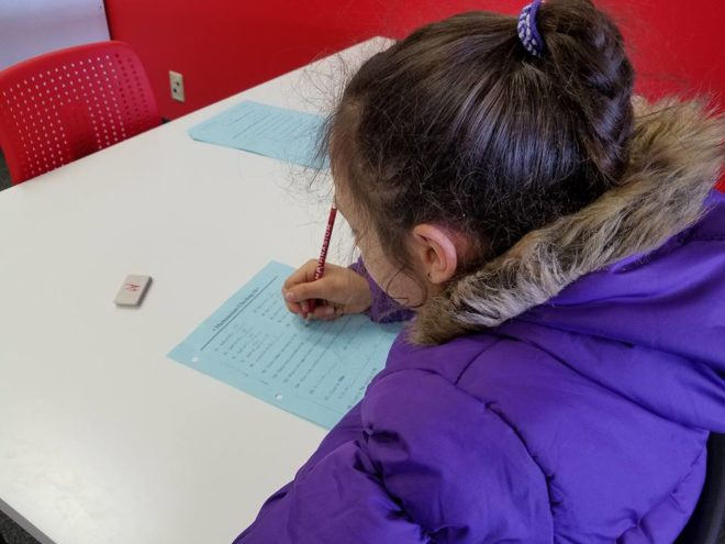 Girl practices math at Mathnasium
