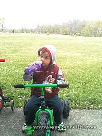 Boy on small trike sunscreen