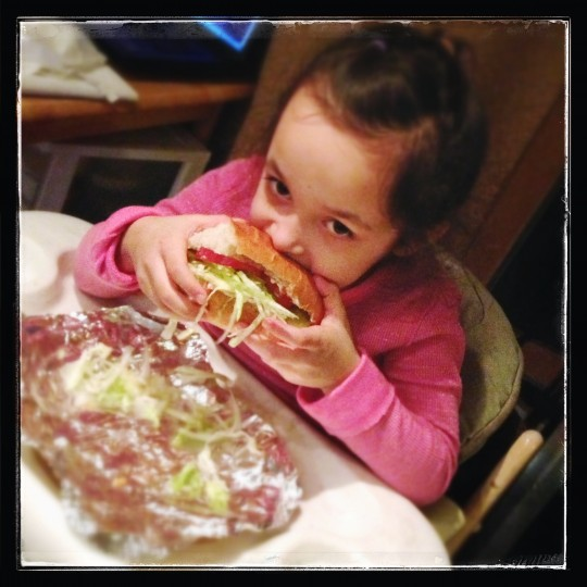 Smartphone Photography - Picture of the girl eating a huge sandwich