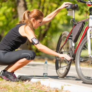 Woman is checking bicycle tire