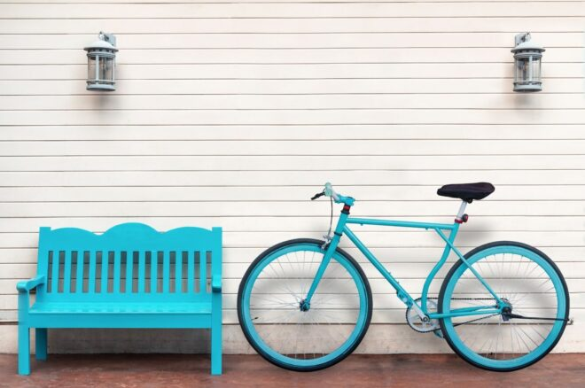 blue bicycle next to blue bench