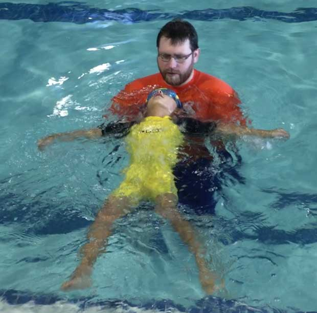 Boy-swim-with-instructor