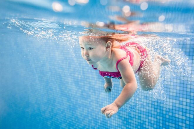 Baby swims under water