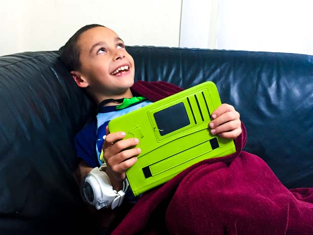 Boy is laughing with a tablet