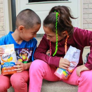 Boy and girl with Goldfish crackers