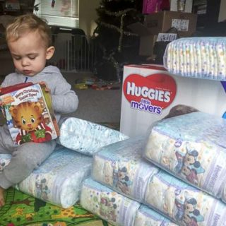 Who is on the diaper duty - child reads book in a pile of diapers