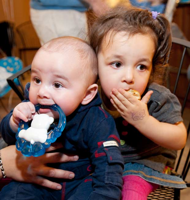 Toddler girl and baby boy are eating