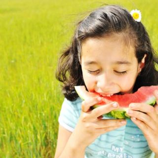 kid girl eats watermelon