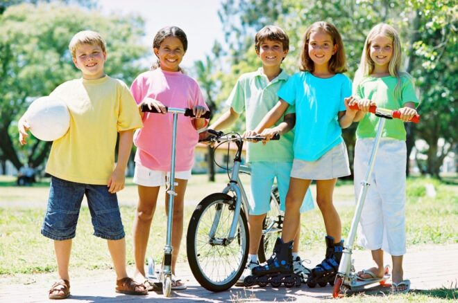 a group of preteens standing outside