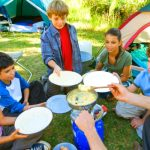 children getting ready to eat at camping site