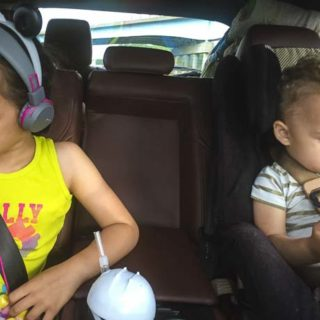 Kids sit in Mazda