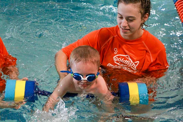 Boy is learning to swim at Goldfish swim school