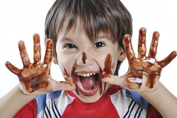 Funny boy messy face chocolate