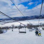 Ski at the Chestnut Mountain Resort traveling on ski lift