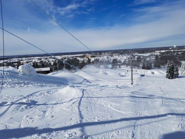 Where can you go snow tubing, skiing or snowboarding near Chicago? Here are must-do things while skiing or snow tubing at the ski resort in Chicago suburbs