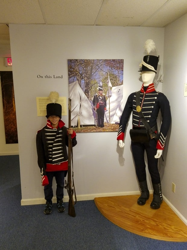 Boy wears soldier costume in the Battle Ground, Indiana museum