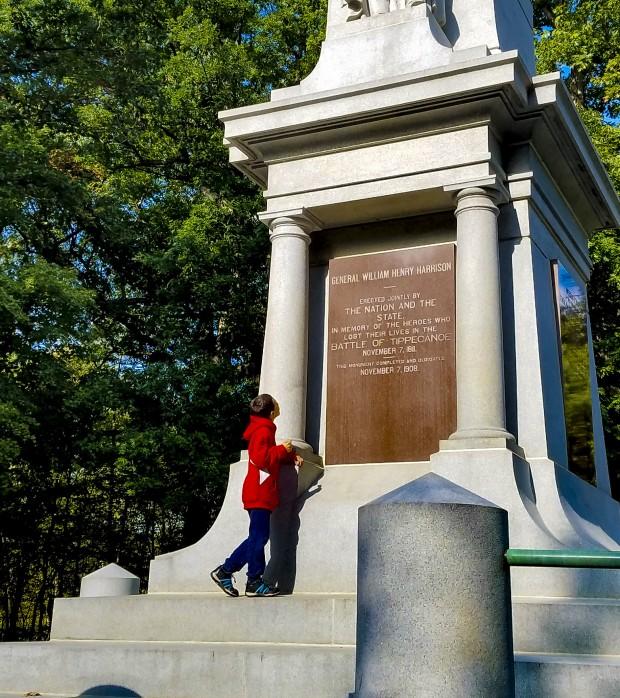 Boy stands in front Lafayette Tippecanoe Battlefield monument