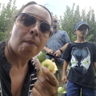 Family eats apple at the Orchard in Hendricks County