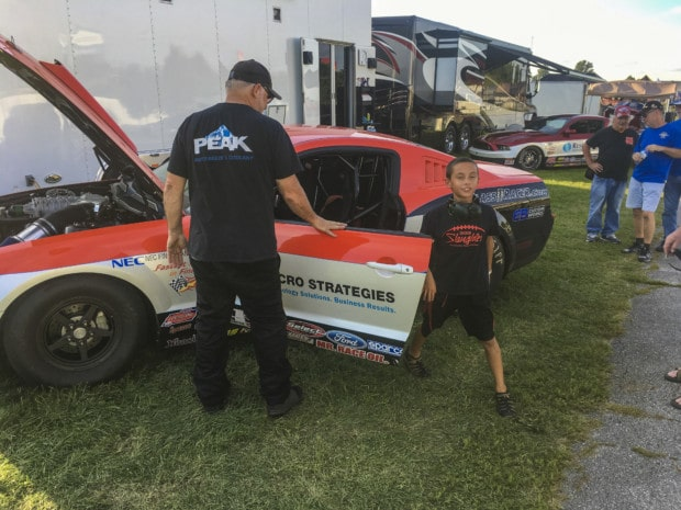 Lucas Oil raceway boy comes out of the car