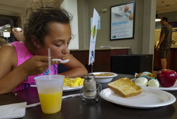 Port Clinton girl eats hotel breakfast