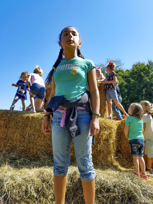 girl standing straw pile Johnson County Indiana Festival Country