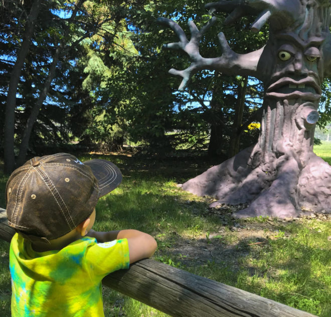 Boy watches haunted forrest at Land of Oz at Storybook Land Aberdeen South Dakota