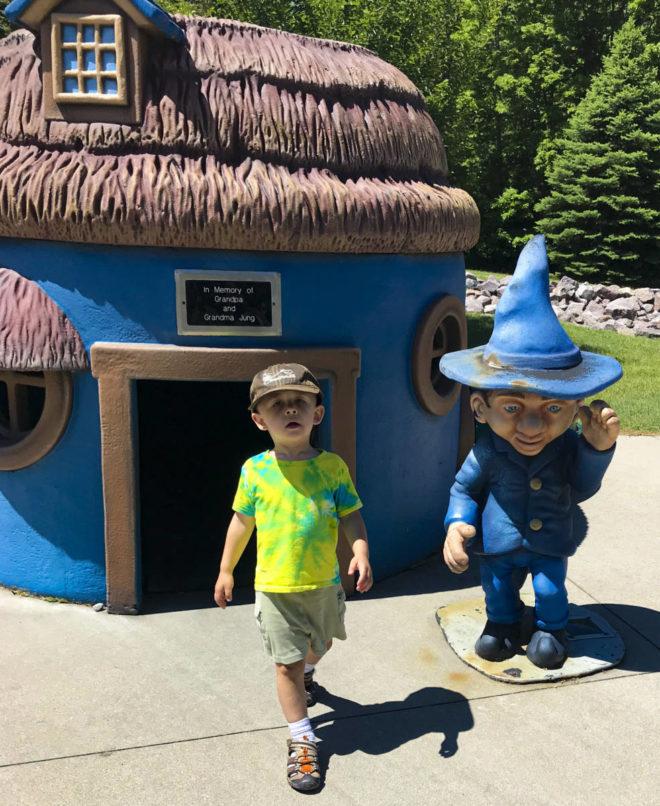 Boy in a munchkin land at Land of Oz in Storybook Land Aberdeen South Dakota