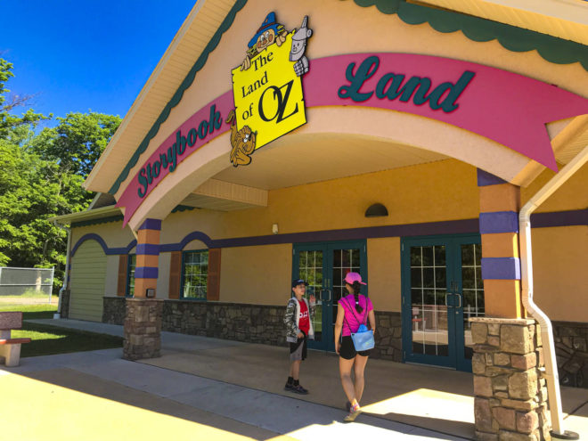 Kids stand by the sign of at Land of Oz in Storybook Land Aberdeen South Dakota