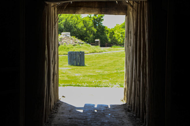 Look out of earthlodge in Mandan Native American village at Abraham Lincoln State Park