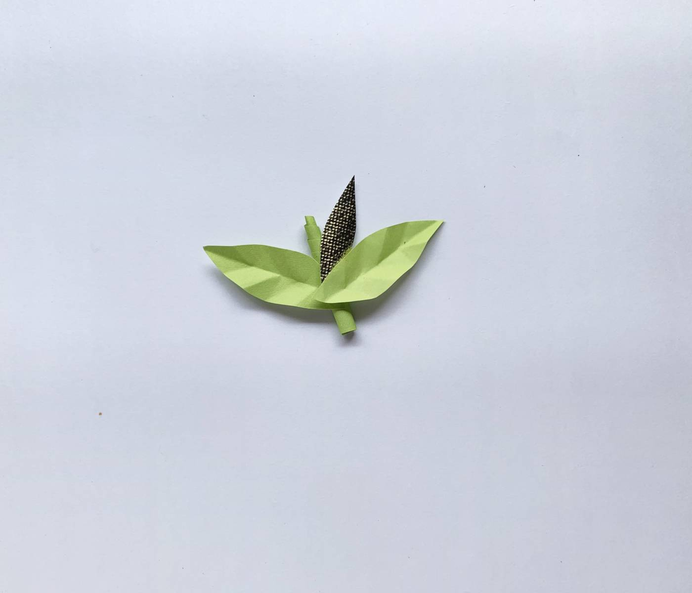 a fake stem with paper leaves on it