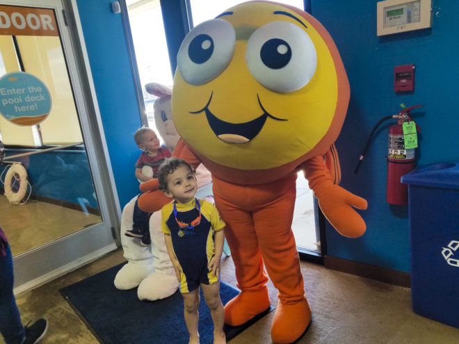Boy and Goldfish Mascot while attneding swimming classes in winter