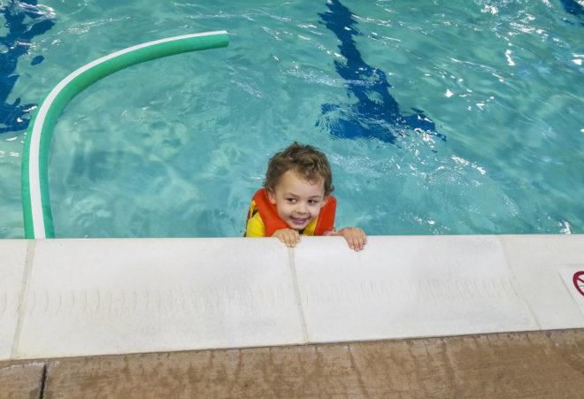 boy in water attending swimming classes in winter