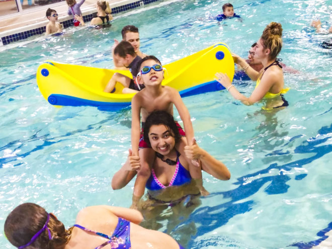 kids in a pool during swimming classes in winter at the Goldfish Swim School
