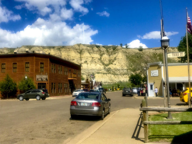 A road and cars in front of Rough Rider hotel in Medora, ND