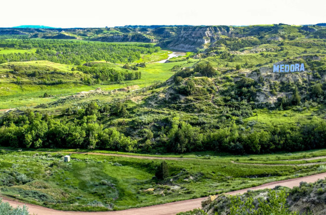 A view of Medora spelled on mountain off the hill top