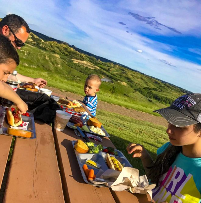 Family is eating at Pitchfork Fondue in Medora, ND