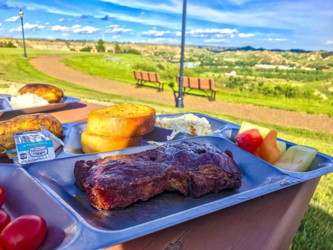 A piece of meat on a tray at Pitchfork Fondue in Medora
