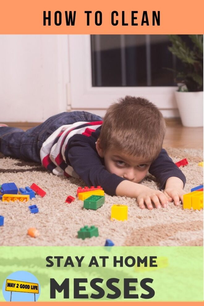 boy lays on carpet surrounded by lego bricks