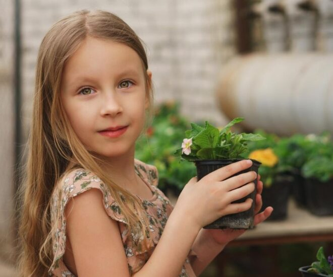 Girl hold a flower pot in her hands