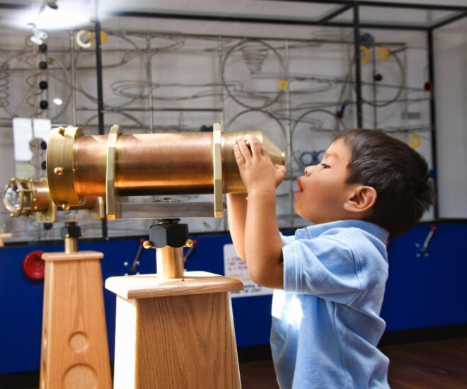 Military Museum - Boy is looking through optical tube