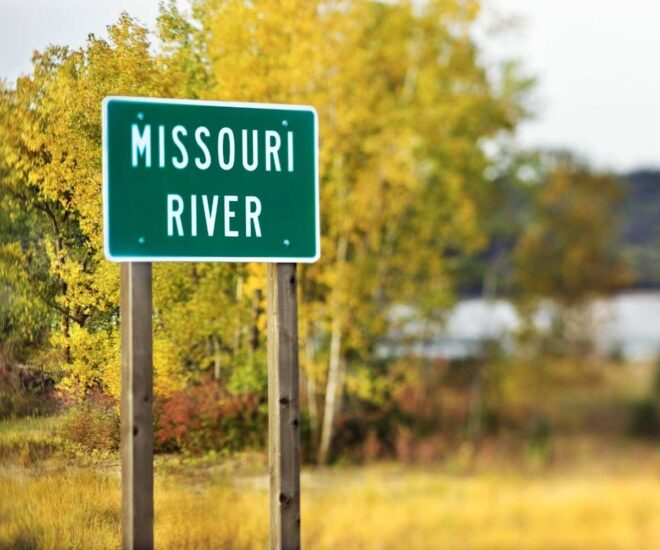 Missouri River sign in front of wooded landscape