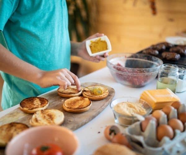 Boy making bread sandwiches