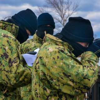 3 sea cadets practicing geo locating things