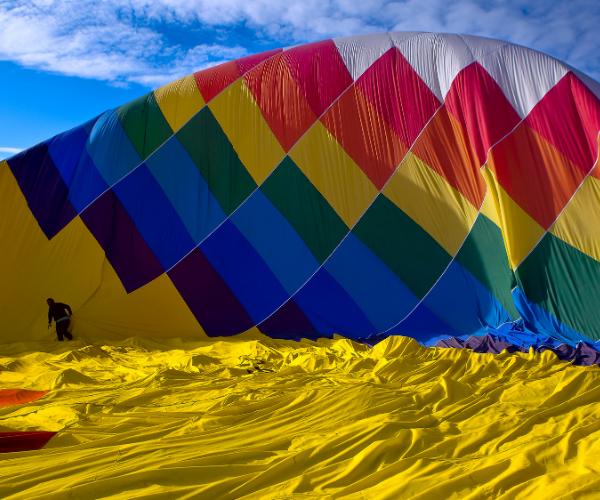 A hot air balloon closeup on the ground