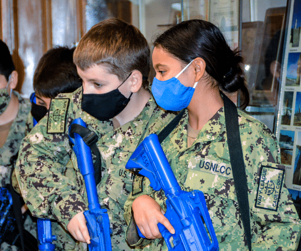 Boy and girl sea cadet with training riffles