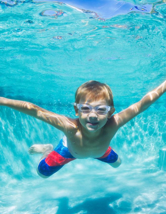 Boy swims under water