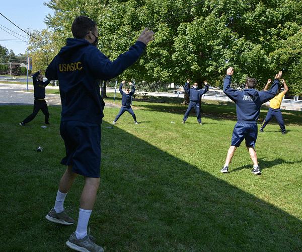 Sea cadet group practes jumping jacks
