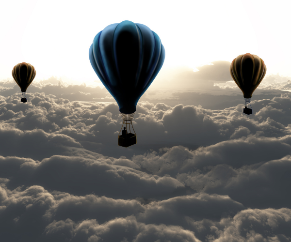 Three hot air balloons in cloudy skies